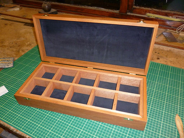 Custom wooden box with compartments.
